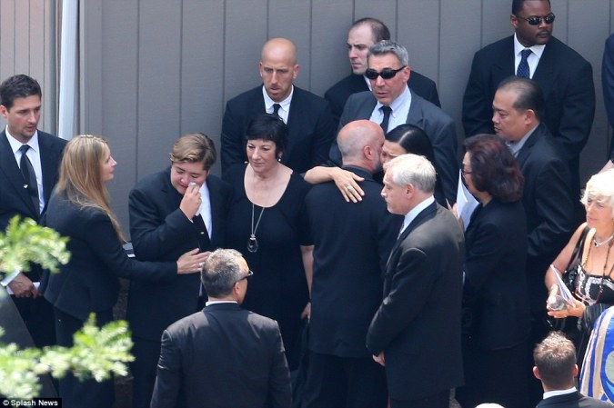 Comforted: James Gandolfini's son, Michael, is comforted byhis mother Marcy Wudarski, left, and other family members