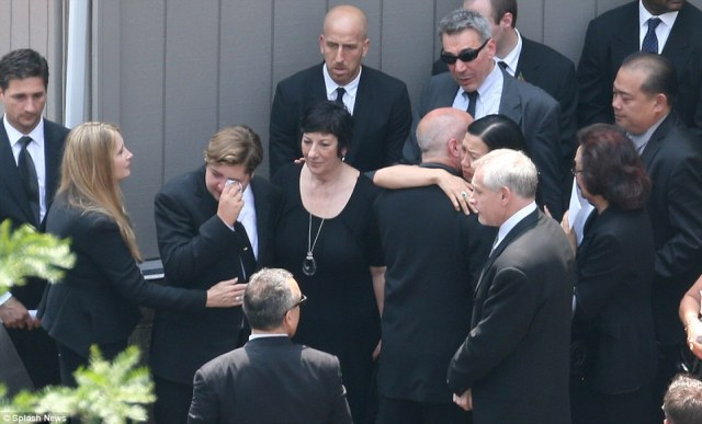 Tragic: James Gandolfini's wife, Deborah Lin, second from right, his son, Michael and ex wife Marcy Wudarski, left cry after the funeral