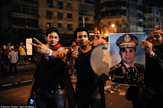 Taking to the streets: Opponents of Egyptian President Mohammed Morsi celebrate near the Presidential palace
