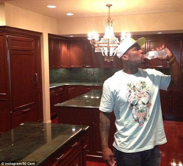 'I'm free': 'I'm not in jail I'm in my kitchen fool#smsaudio' 50 posted as he sips from a water bottle in his kitchen