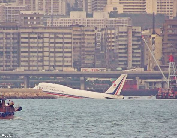 Washed up: A jumbo-jet crashes into the water when landing at Kai Tak Airport, Hong Kong. Planes would sometimes run over the landing and plunge into the sea