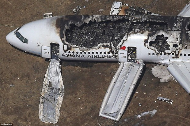 Tail snapped: Onlookers said that the plane's tail snapped off when the plane crashed down near where the runway meets the water at the airport