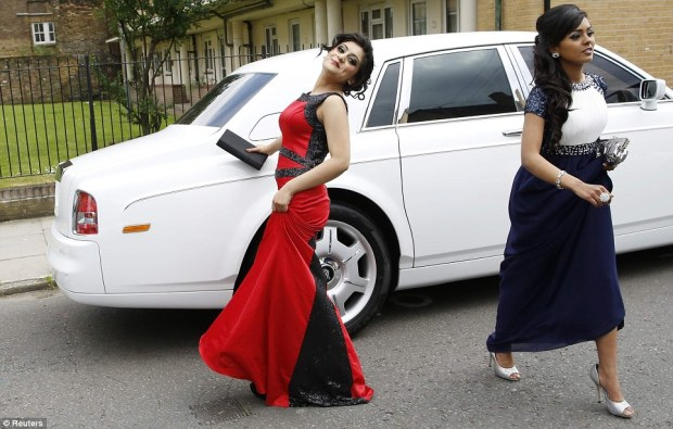 Larking about: Tahmina Ahmed, 16, poses in front of a Rolls Royce hired by friends for a parade of 'supercars' to celebrate leaving school