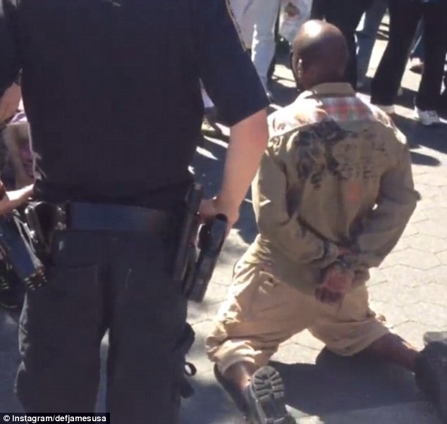 Arrest: Lashawn Marten, seen handcuffed in Union Square, could be charged with a hate crime