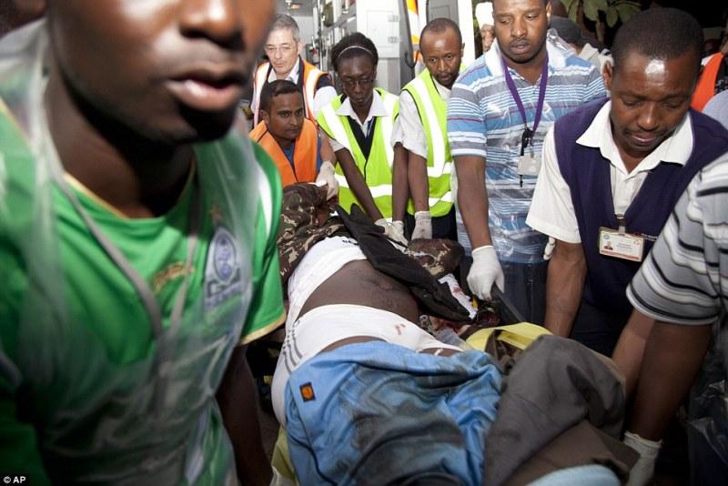 Critical: A victim is wheeled into the Aga Khan Hospital in Nairobi for emergency treatment