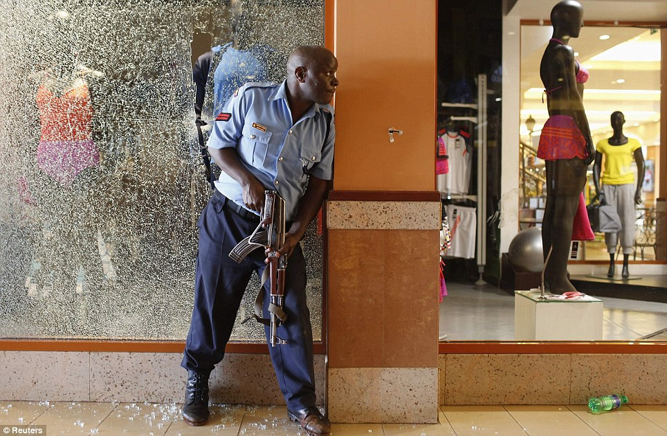 Shattered glass: A police officer tries to secure an area inside the Westgate Shopping Centre where gunmen went on a shooting spree in Nairobi