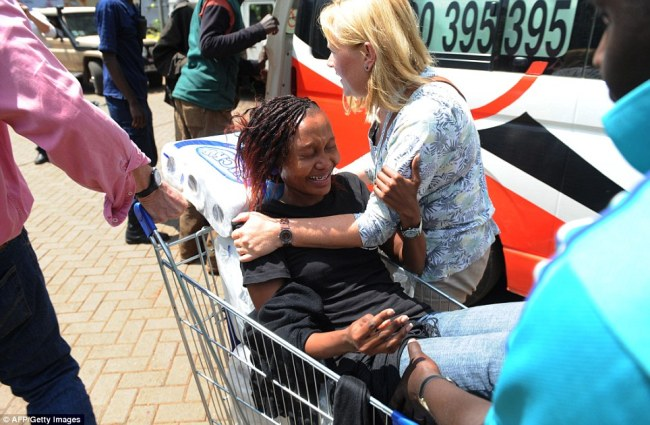Saved: A woman sobs as she is brought out of the shopping center in a cart after terrorists launched an attack on Saturday