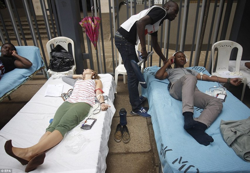 Kenyans lie on stretchers to donate blood for the victims of the Westgate terror attack on Sunday after the country's president urged volunteers to come forward following the atrocity