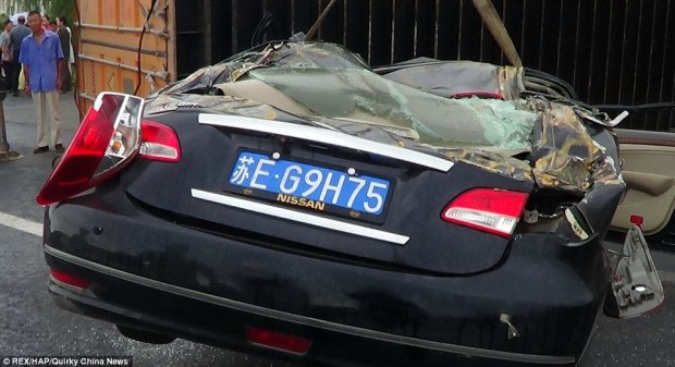 Write-off: The woman's Nissan was left ruined by the impact