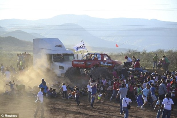 Out of bounds: At the 'Extreme Aeroshow' in Chihuahua, Mexico yesterday, a monster truck driver lost control of his vehicle and drove into a crowd of spectators