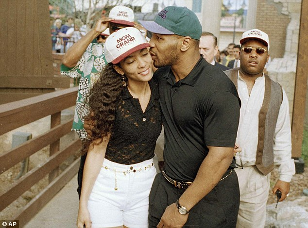 Mike Tyson seen with his second wife Monica Turner in April 1995 - he told Monica that he had AIDS - which was untrue