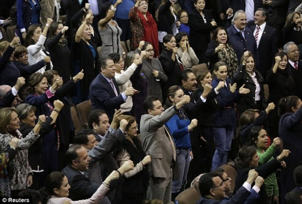 Victory: Mexican congressmen celebrate after the lower house gave the final approval to a landmark energy reform in Mexico City December 12