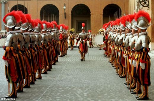 Scandal: The former member of the Swiss Guard, which is responsible for protecting the Pope, alleged an active 'gay lobby' at the heart of the Vatican. (File photo of Swiss Guards who are not connected to the claims)