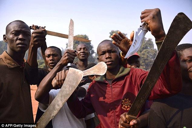 Men brandish machets and knives to threaten Muslim people in Bangui