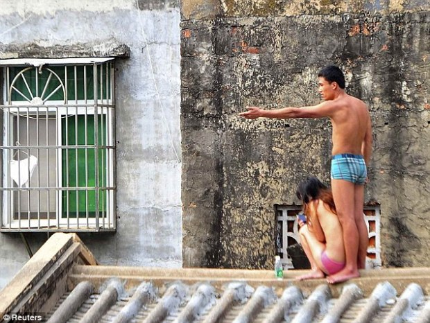 Naked: The man then stripped to his underwear and forced his terrified girlfriend to do the same, reportedly to shame her in front of their neighbours. Some reports said he had suspected her of having affairs
