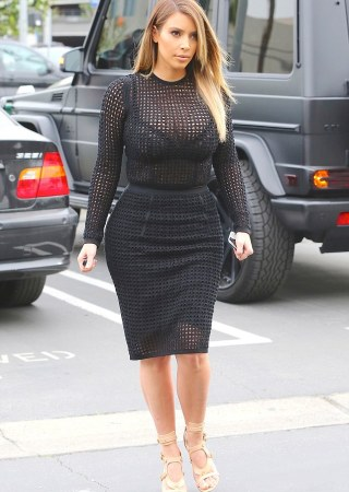 Peekaboo! Kim Kardashian left little to the imagination on Friday as she stepped out in Los Angeles wearing a tight and very see-through dress revealing her bra beneath