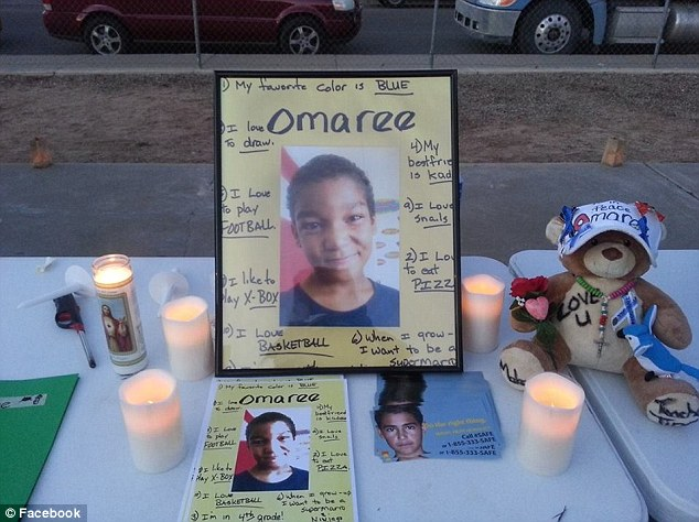Heartbreaking: This memorial was set up outside Omaree Varela's home shortly after he was found dead