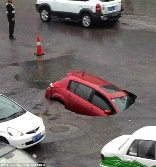 Trapped: A family were in a car when it fell into a sink hold in Hetian, Xinjiang, China