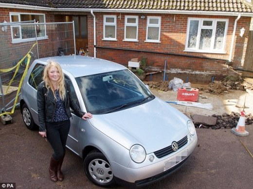 Brand new: Zoe Smith, 19, was given a replacement after the car was engulfed by the hole which developed outside her home