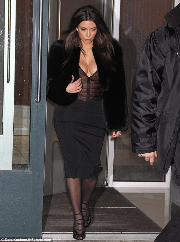 Show time! Kim wore a plunging blouse and strappy high heels for the New York City soiree