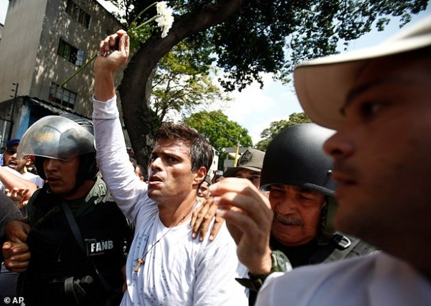 Opposition leader Leopoldo Lopez is flanked by Bolivarian National Guards after he surrendered, in Caracas, Venezuela