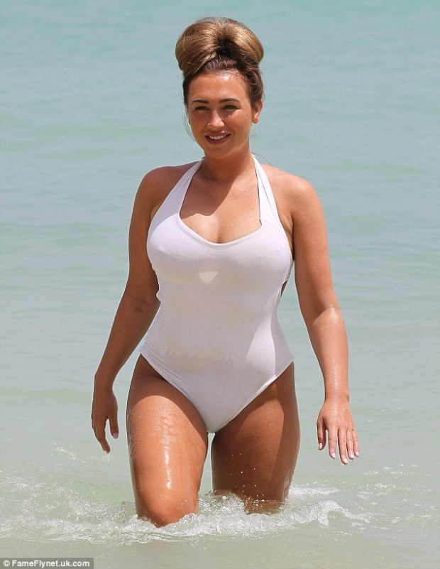 Taking a dip: The former TOWIE babe strides out of the Pacific surf - but doesn't look particularly wet following her dip in the ocean