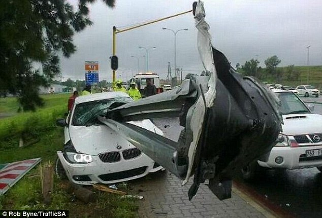 How did he survive? Rooi Mahamutsa's BMW was pictured after his horror car crash in South Africa