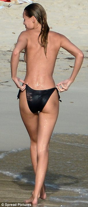 Cheeky girl: Edita looked invigorated after her splash in the sea and displayed her pert derriere in the swimwear