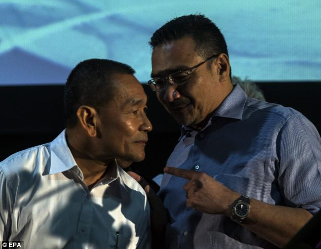 Hishammuddin Hussein, (right) Malaysia's defense minister and acting transport minister, told reporters in Kuala Lumpur that the cost of mounting the search was immaterial compared to providing solace for the families of those on board by establishing what happened
