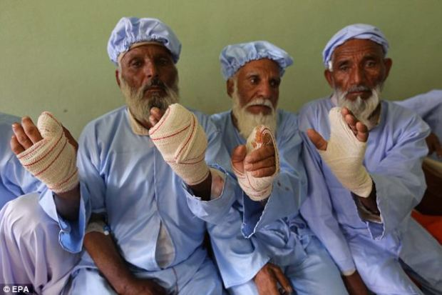 Fear and terror: Taliban insurgents sliced off the fingers of 11 people as punishment for voting in Afghanistan¿s democratic presidential election while 60 people were killed in a series of rocket barrages and scattered attacks
