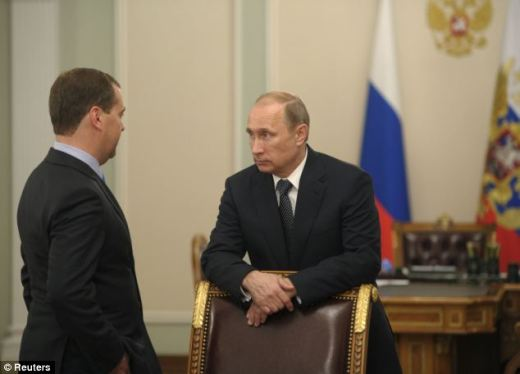 Russia's President Vladimir Putin (R) talked to Russia's Prime Minister Dmitry Medvedev after word reached Moscow of the attacked aircraft