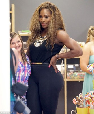 Svelte shape: The beauty showed off her curvy form in a chic black ensemble with metallic accessories