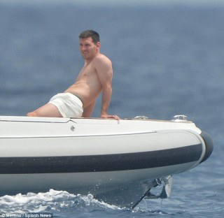Relaxation: Lionel has been enjoying some time out after playing for Argentina at the Brazil World Cup