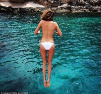 Jump! Millie Mackintosh posted a picture of herself jumping into the sea topless in Ibiza on Thursday