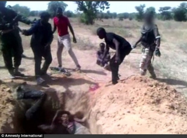 The video also shows a man's body being hurled into the mass grave while men in military outfits watch on. Nigerian Defence has said it 'take these grave allegations very seriously'