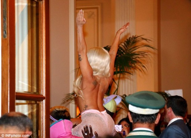 There she goes! Gaga kept her arms high as she made her way into the building