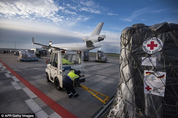 Staff load component of an Ebola treatment centre on to an aid plane bound for Sierra Leone where the deadly virus is killing thousands, butMr Ogunnoiki had not travelled there but 1,800 miles away in Nigeria (file photo)