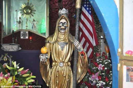 Grinning Reaper: The statue of Santa Muerte in a Mexico City shrine, now idolised by an estimated 10m people around the world. She offers protection, revenge and a 'chance of a good death', claim devotees