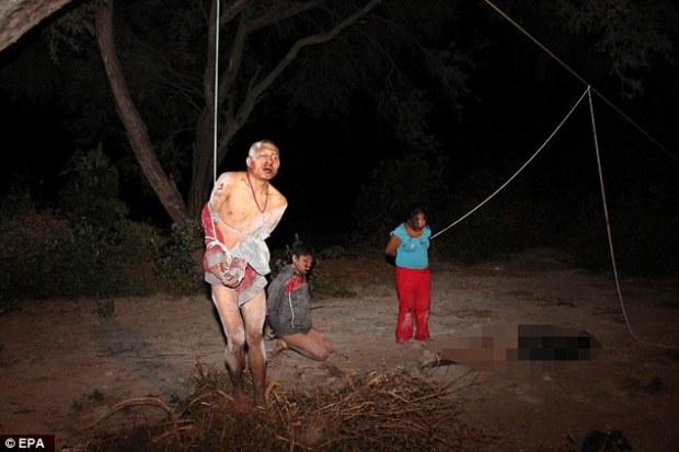 Four alleged thieves (pictured) were caught red-handed in Tehuacan, Mexico, while robbing a home. They were stripped and beaten with metal pipes. One died of his injuries