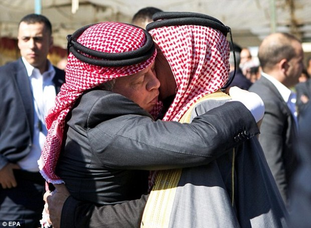 Embrace: Jordan's King Abdullah II hugs Saif al-Kassasbeh, father of Jordanian pilot Moaz al-Kasasbeh, during a trip to the family's ancestral home. The King promised a 'harsh' revenge for Kasasbeh's brutal death