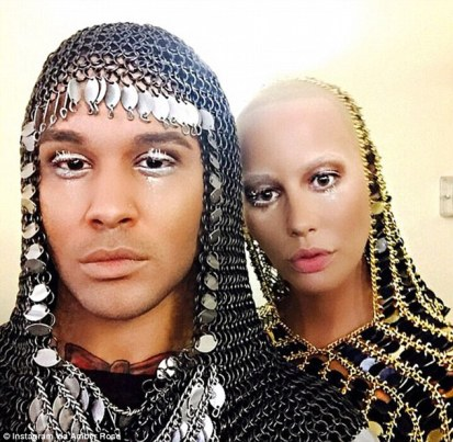 Going medieval:Amber also shared a snap of her with her assistant, Benji Carlisle, looking like a knight decked out in his chainmail, captioned: 'Muva and her assistant @thatsbenji killed the runway today'