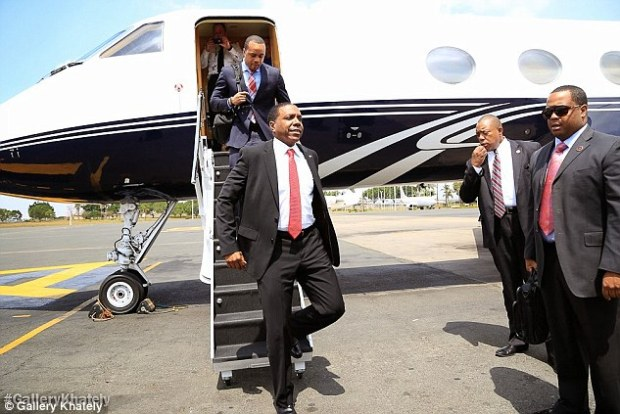 Frequent flyer: The Rev Creflo Dollar arrives in Kenya on his previous private jet. It was involved in a collision on the ground in the UK and he launch an appeal for a Gulfstream G650, the world's fastest business jet