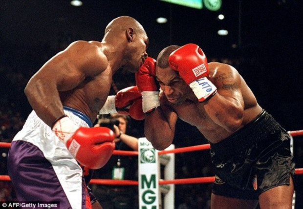 Infamous: Evander Holyfield is best known for the so-called bite fight, when he clashed with Mike Tyson in June 1997 and Tyson took a chunk out of his ear