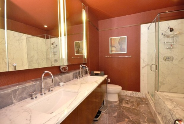 Flush with success: The two-bedroom apartment boasted marble-clad bathroom with his-and-hers sinks, as well as views of the city