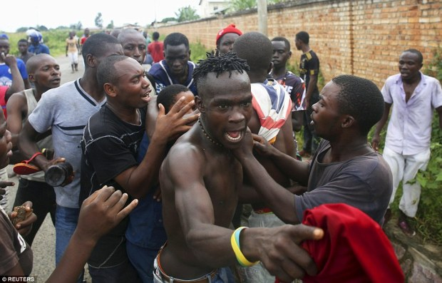 Officers opened fire on demonstrators amid furious clashes on the streets of the capital Bujumbura, as Pierre Nkurunziza defied international pressure to cease his latest campaign for president