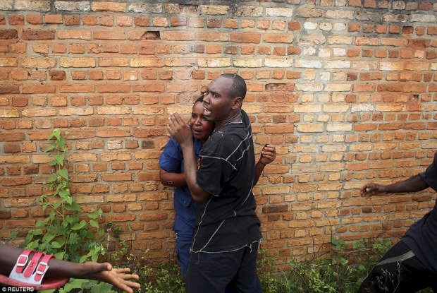 The man in the black t-shirt comforts the female officer and her colleagues finally manage to take control of the situation