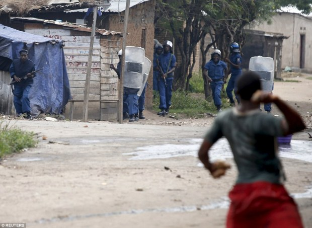 Officers fired tear gas to break up a crowd of some 200 stone-throwing youths inBujumbura
