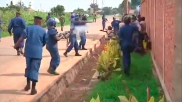 Firepower: The female officer slowly moved towards the rioters, who stand pressed against a brick wall. Moments later a brief scuffle between one of her colleagues and a demonstrator leads to her shooting at the man from no more than ten feet