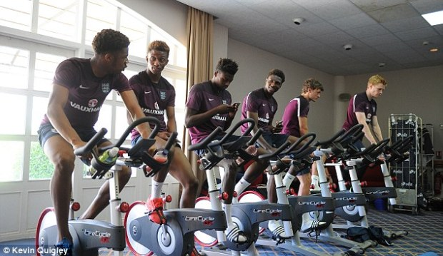 England players (pictured left to right - Akpom, Demarai Gray, Iorfa, Hause, Swift and Duncan Watmore)exercise on a bike as they prepare for the Toulon Tournament, which started in May