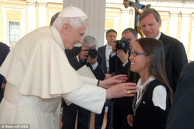 Holy task: Jessica Cox receives a special blessing from the Pope after receiving her Guinness World Record for being the first licensed armless pilot